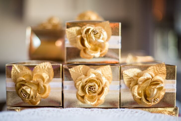 Each guest left with a customizable drink charm packaged in a rosette-topped gold box.