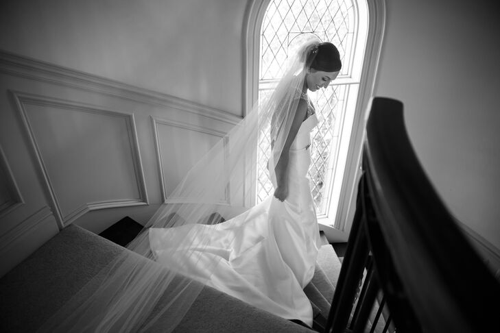 As Jackie walked down the staircase, her elegant cathedral-length veil simply made of tulle trailed behind her. She purchased the veil at Martina's Bridal—the same bridal store where she bought her dress.