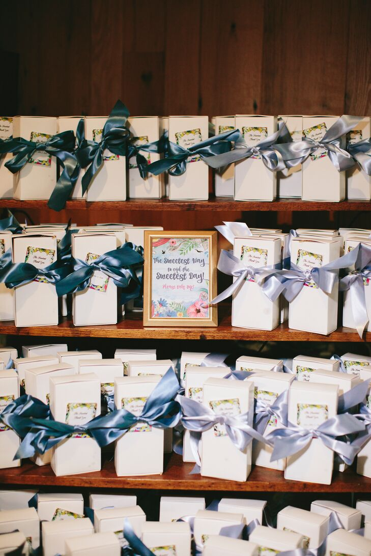 """""""I wanted to send our people home with something personal. Mark's mom and grandma make the best cookies every year,"""" says Abbie, who asked them to share two recipes, which were then crafted by the cake bakers. """"We packaged them in a simple box, threw them in a tea bag and added a note with the story of the cookies attached."""""""