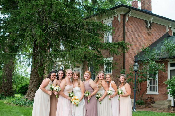 Cassie's bridesmaids wore floor-length dresses in different styles and different neutral shades. Cassie let them pick their dresses so that they would be comfortable. They carried smaller versions of Cassie's bouquet.