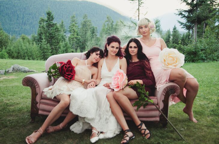 Justine's bridesmaids wore dresses of different styles in shades of blush and burgundy and carried oversize roses instead of bouquets.