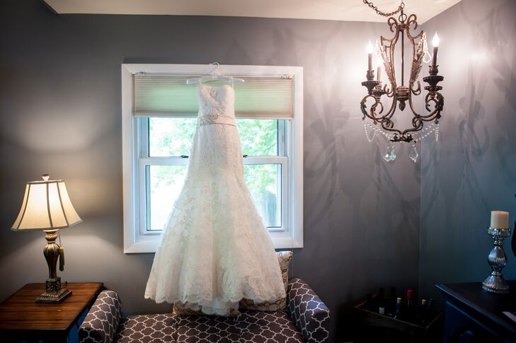 Amber wore a strapless fit-and-flare Mori Lee dress with a blush sash. The dress included a lace caplet that she wore for the ceremony but removed for the reception.