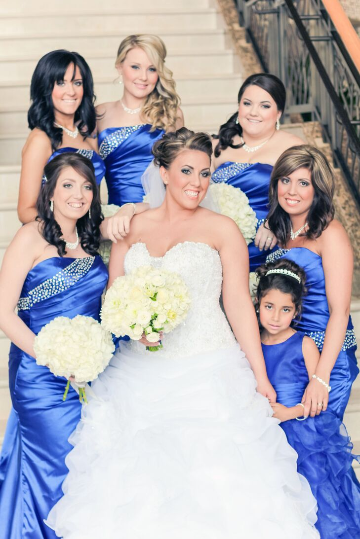 a4269332d3d Amy s bridesmaids wore royal blue dresses with crystal embellishments to  match the modern glam wedding style