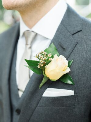 Ivory Garden Rose Boutonniere Against Gray Suit