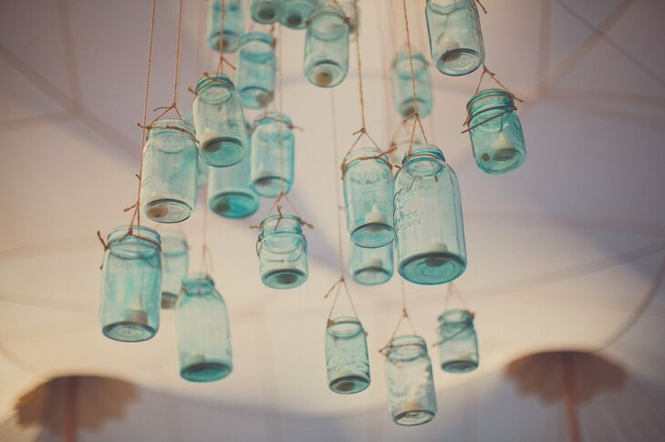 Hanging clusters of blue mason jars filled with votive candles made a unique lighting feature.