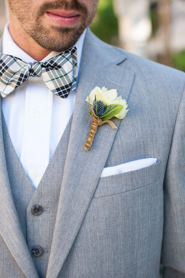 Craig had a single ivory rose boutonniere accented with greens pinned to his light gray suit jacket. He wore a light gray vest underneath the jacket, along with a gray and white plaid bow tie.