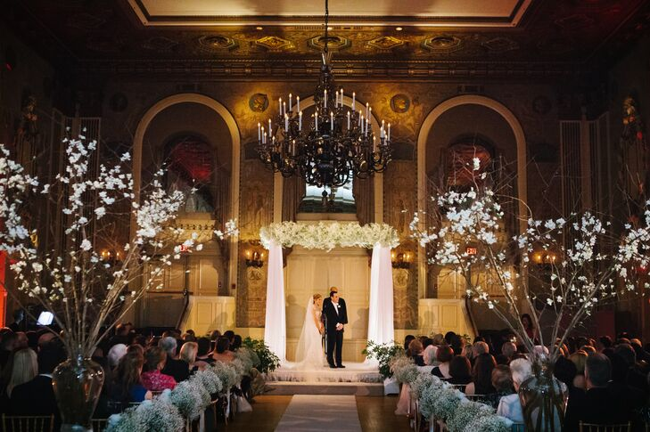 A romantic ceremony kicked off the evening, with Grier and Jonathan gathering their families and friends in the Hotel du Pont's lavish Gold Ballroom. The couple incorporated traditions from Grier's Christian and Jonathan's Jewish backgrounds, including the sign of peace, sharing of the wine and breaking of the glass. Quince and bundles of fluffy white baby's breath framed the aisle, while a chuppah decorated with panels of sheer white fabric and a lush display of hydrangeas, and baby's breath served as the focal point of the room.