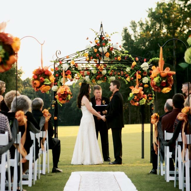 Amber and Chad married on the golf course's fairway with a ceremony that the bride says reflected our Southern Baptist upbringing but also brought in their unique personalities. As the newlyweds walked back up the aisle, they had the traditional wedding march interrupted by James Brown's I Feel Good.