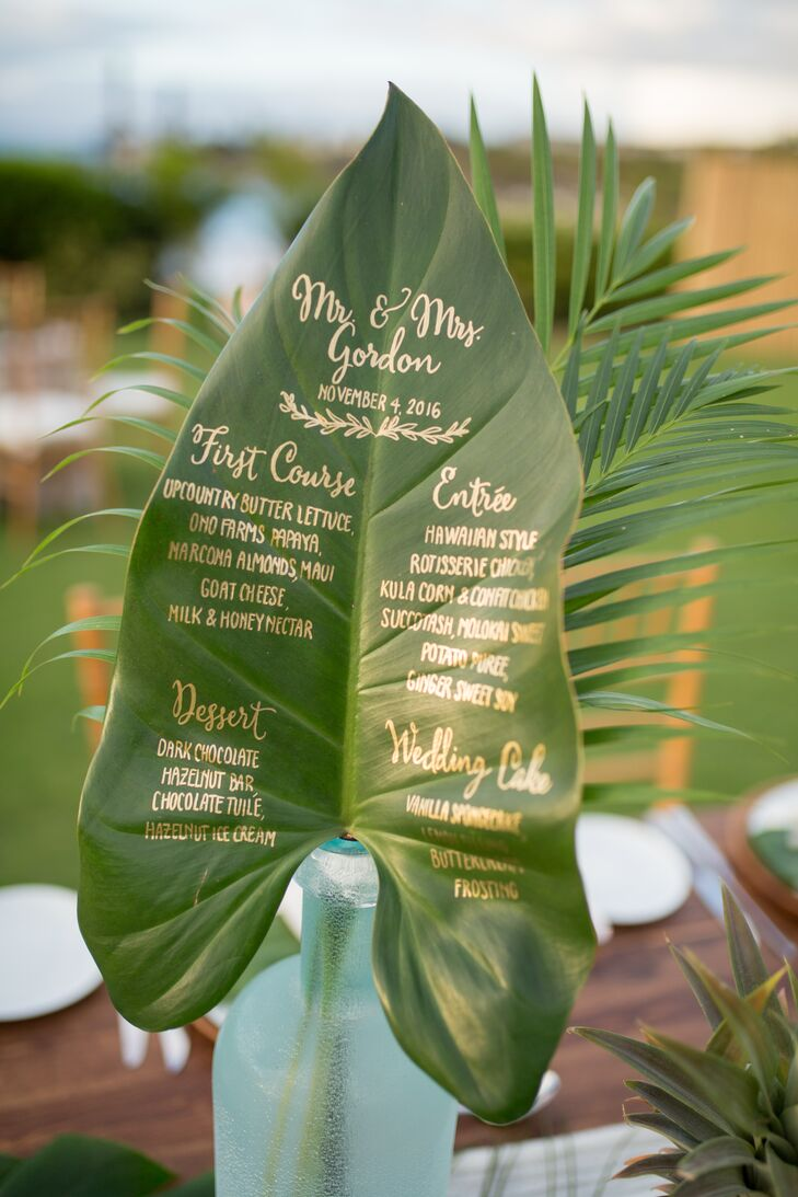 Each menu was calligraphed in gold on a large tropical leaf.