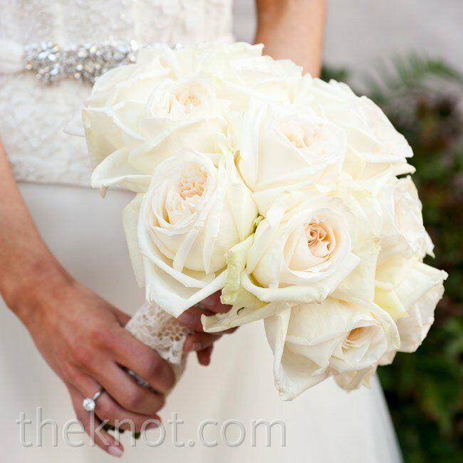 Allison's classic bouquet contained only one kind of flower: large white roses.