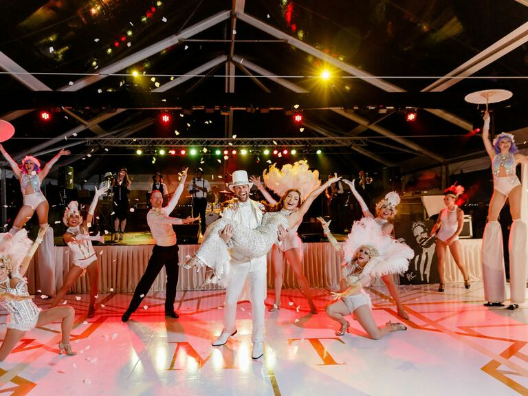 Bride and groom with professional dancers at wedding reception