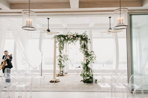 Minimalist Ceremony with Greenery Chuppah and Ghost Chairs