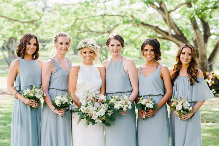 Olivia's bridesmaids wore coordinating Show Me Your Mumu dresses in a teal green.