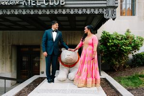 Indian Groom in Classic Tux and Bride in Pink and Gold Lehenga