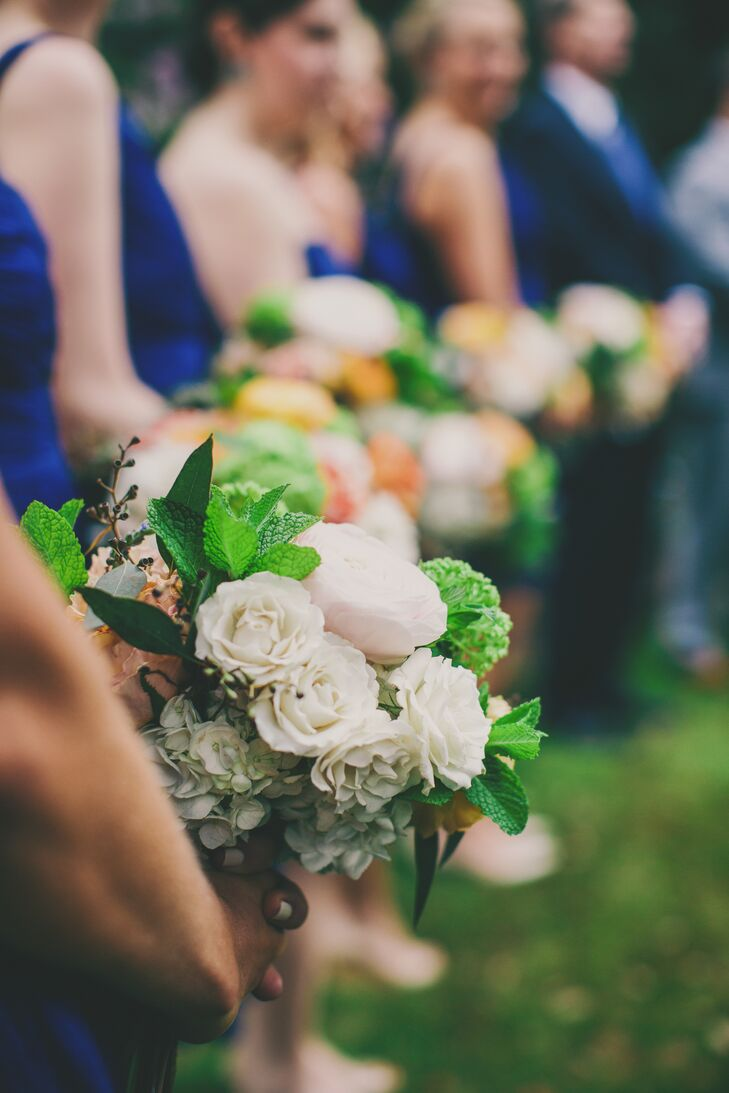 "Hydrangeas (Katie's favorite flower) were the focal point of all bouquets and flower arrangements, while vibrant greenery added a pop of color. For her ""something old,"" Katie wrapped her mother's old wedding handkerchief around the handle of her bouquet."
