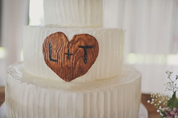 """Around the entire reception, we had things that said 'L +T,'"" says Lee. ""My father being my hero and always my biggest fan, cut down a tree and personally made these for me with our brand—I couldn't fathom anything more special."""
