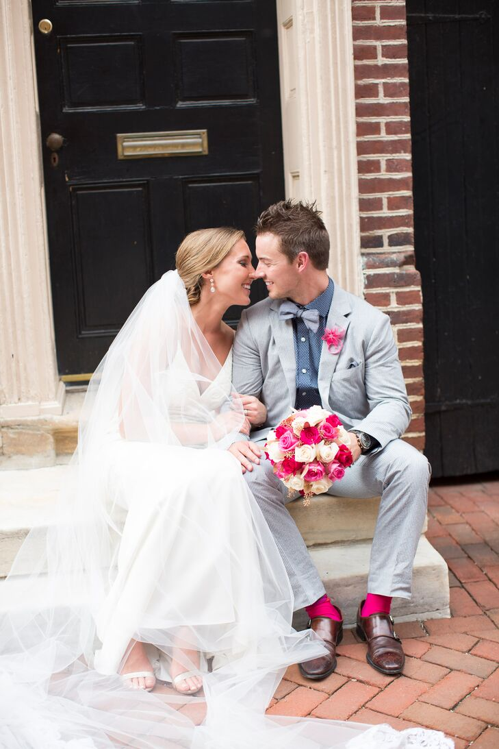 Chad knew he wanted a blue seersucker suit, but chose something with a little more personal flair. He paired it with a blue and white shirt, matching pale blue bow tie and hot pink socks to complement the bridesmaid dresses. His boutonniere was a fuchsia paper flower from Etsy.