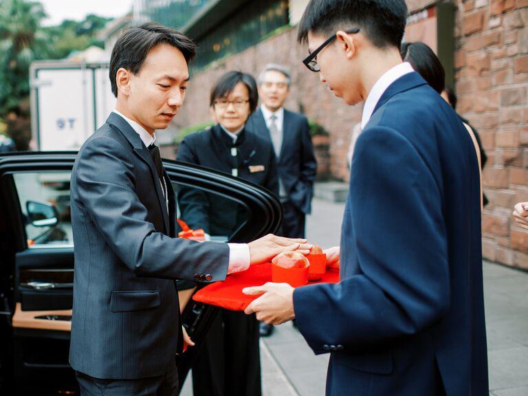 Touching apple during Chinese wedding