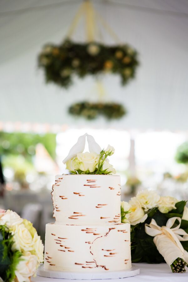 The white wedding cake resembled the look of a white birch tree, with a lovebird topper carved out of wood by a family member. In addition to the cake, guests helped themselves to the ice cream bar provided by Olympic Mountain Ice Cream.