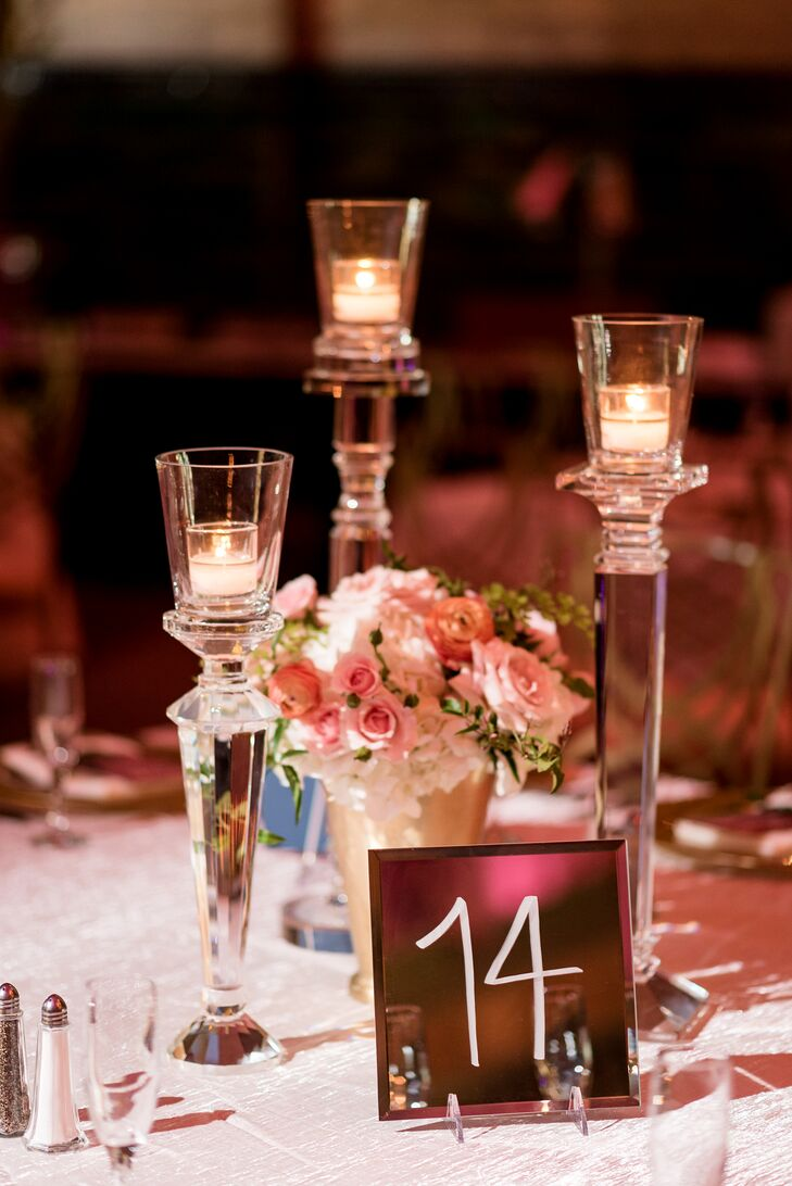Tablescapes varied between large floral arrangements, several smaller floral arrangements and a gorgeous crystal candelabra, and staggering crystal candleholders with a single small floral arrangement. Menu cards were placed on gold chargers, and table numbers were set on small mirrors.