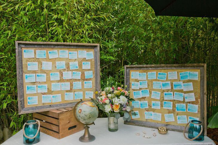 """Instead of table numbers, Mallory and Richie used coordinates of places they had been together, arranged on vintage maps inside large driftwood frames. """"Guests got interactive with it and used the globe we had on the table to find their locale,"""" Mallory says."""
