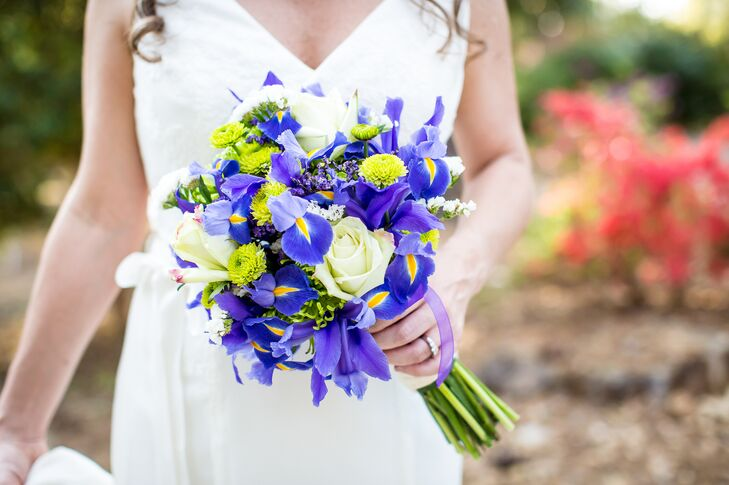 """I ordered the flowers myself, and my sister designed all of the arrangements using green flowers with purple irises as the main focus,"" says Laurelin. ""She made my bouquet very special by wrapping it with a piece of my mom's wedding dress and attaching an antique pin with a picture of my other sister who  passed away."""