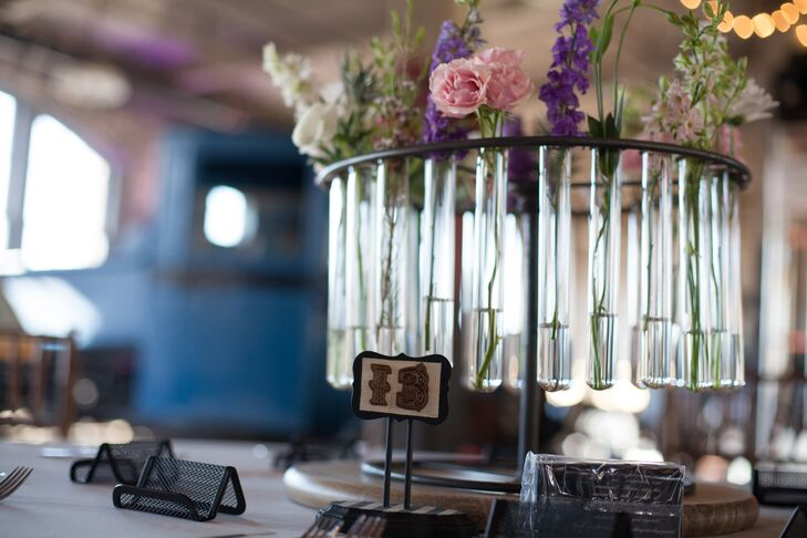 Empty, glass test tubes got a chic spin when used as mini vases for the table centerpieces.
