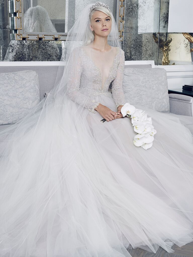 Romona Keveza Collection Fall 2018 wedding dress with a plunging mesh neckline and silver tone