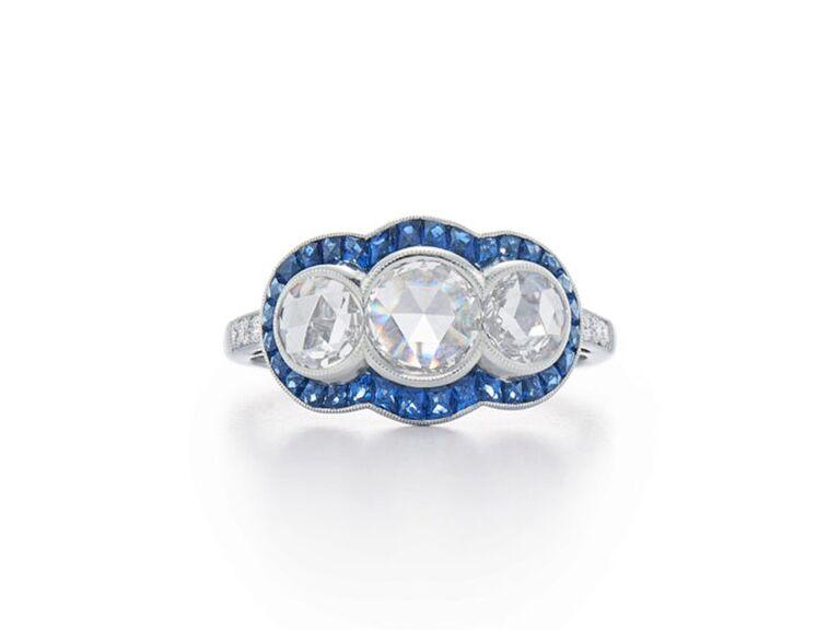 Three-stone round diamond and sapphire engagement ring