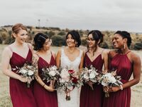 Bridesmaids with loose, low bun hairstyle