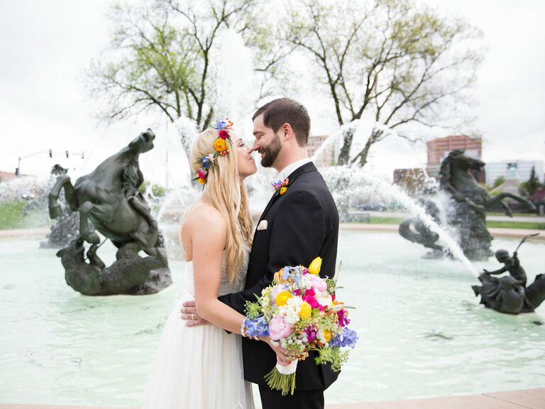 Newlyweds Standing In Front Of Fountain Kansas