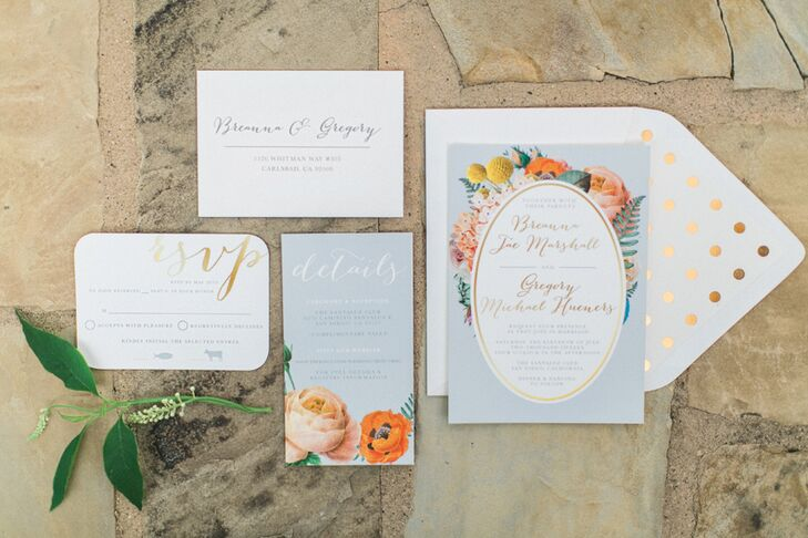The wedding's romantic garden theme was expressed through colorful floral illustrations on pale blue stationery and enhanced with shimmering gold accents.