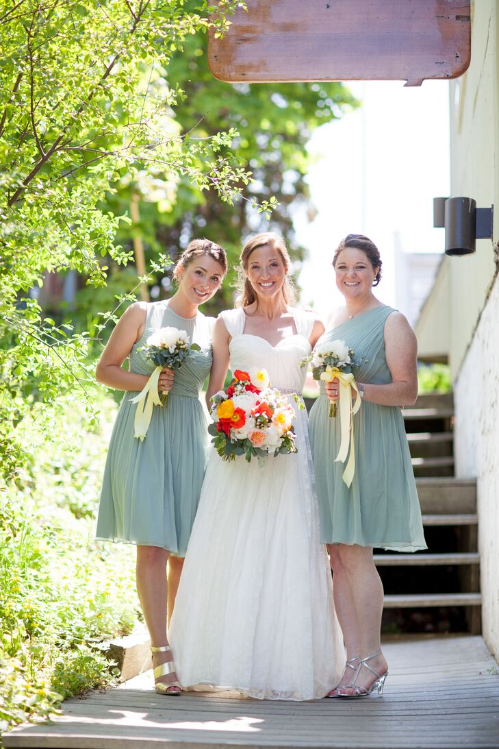 Becca wore mint green shoes to match her bridesmaids. The girls wore knee length mint green dresses in two different styles from the J. Crew wedding line and accessorized with their personal style.