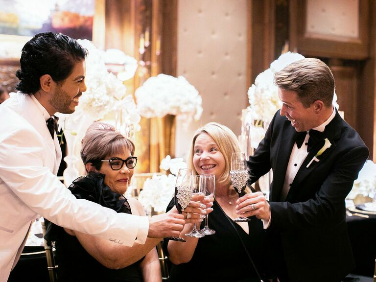 Grooms toasting with their mothers at black-tie glam regencycore wedding