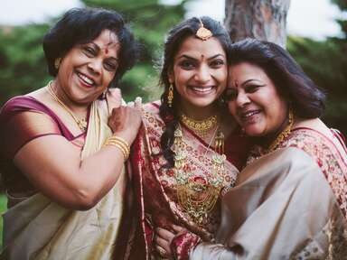 Hindu bride smiling with her family