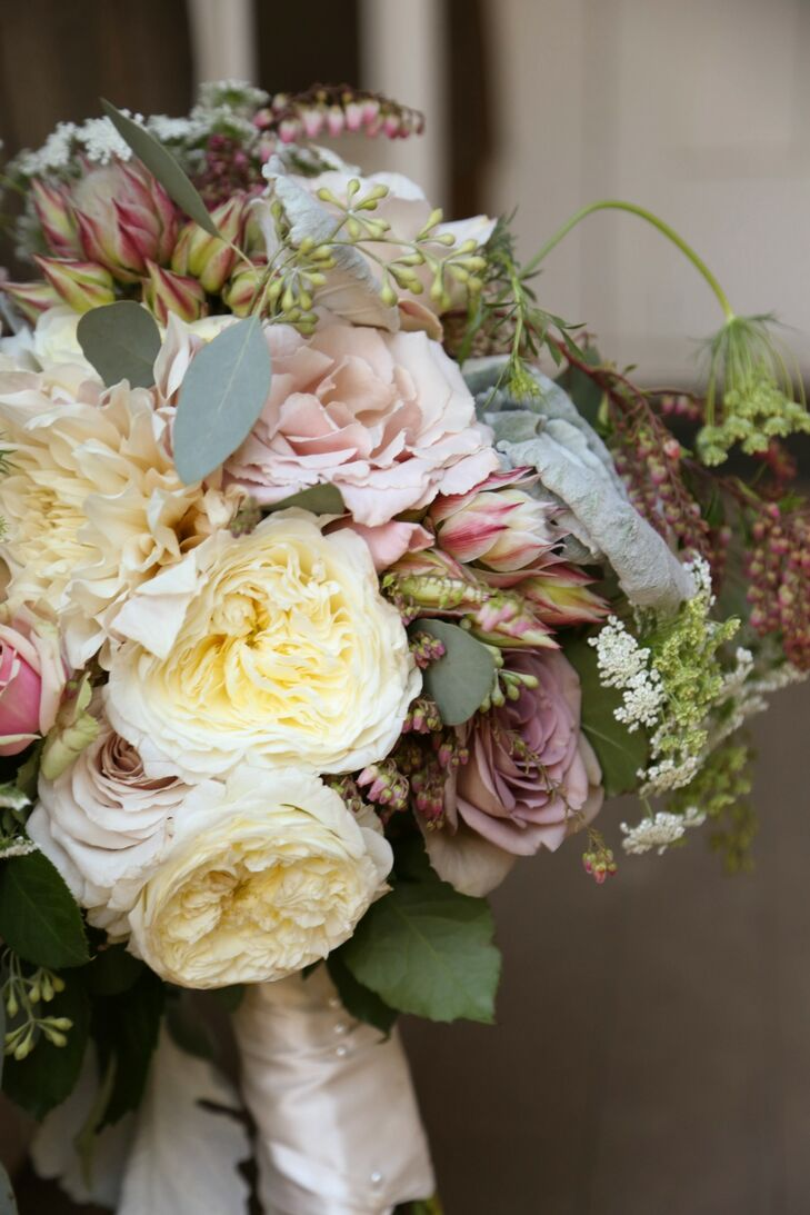 Samantha carried a lush assortment of soft-colored roses and dahlias mixed in with a variety of greens down the aisle.