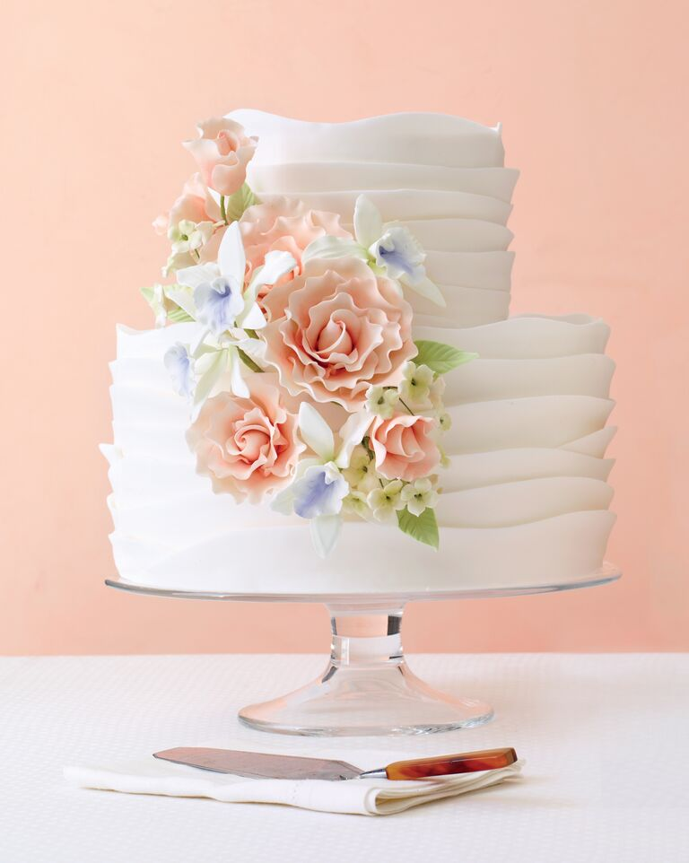 White ruffled wedding cake with sugar flowers