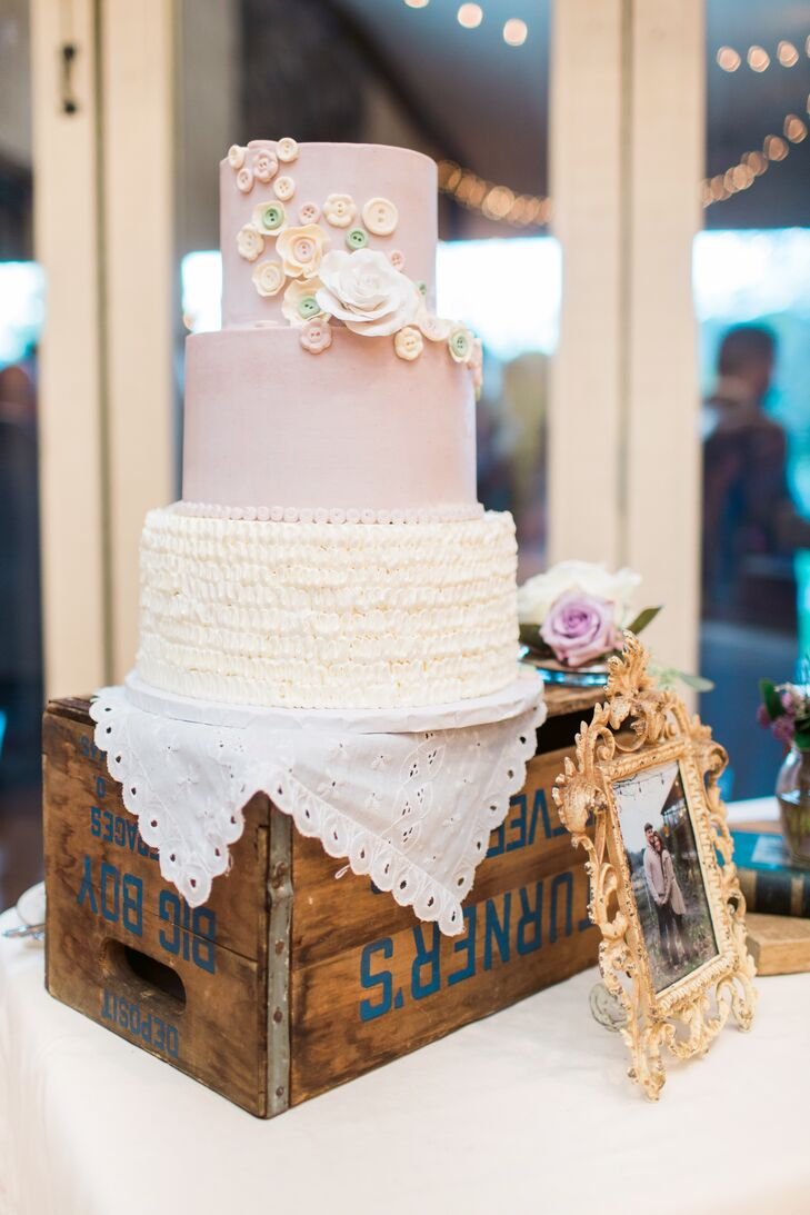 Andrea and Todd also enjoyed a three-tier wedding cake with ruffled white buttercream on the bottom and blush fondant on the top two layers. They were decorated with vintage buttons and a white sugar rose to match the romantic, vintage theme of the wedding.