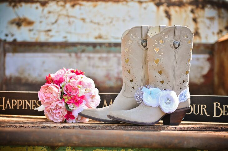 """After Miranda Lambert wore those chic ivory cowboy boots with her wedding dress, Heather knew she wanted the same thing. She paired her dress with neutral cowboy boots that were covered in heart-shaped cutouts. They even had matching metal hearts along the top. """"I'm glad they were comfortable because we danced all night,"""" Heather says."""