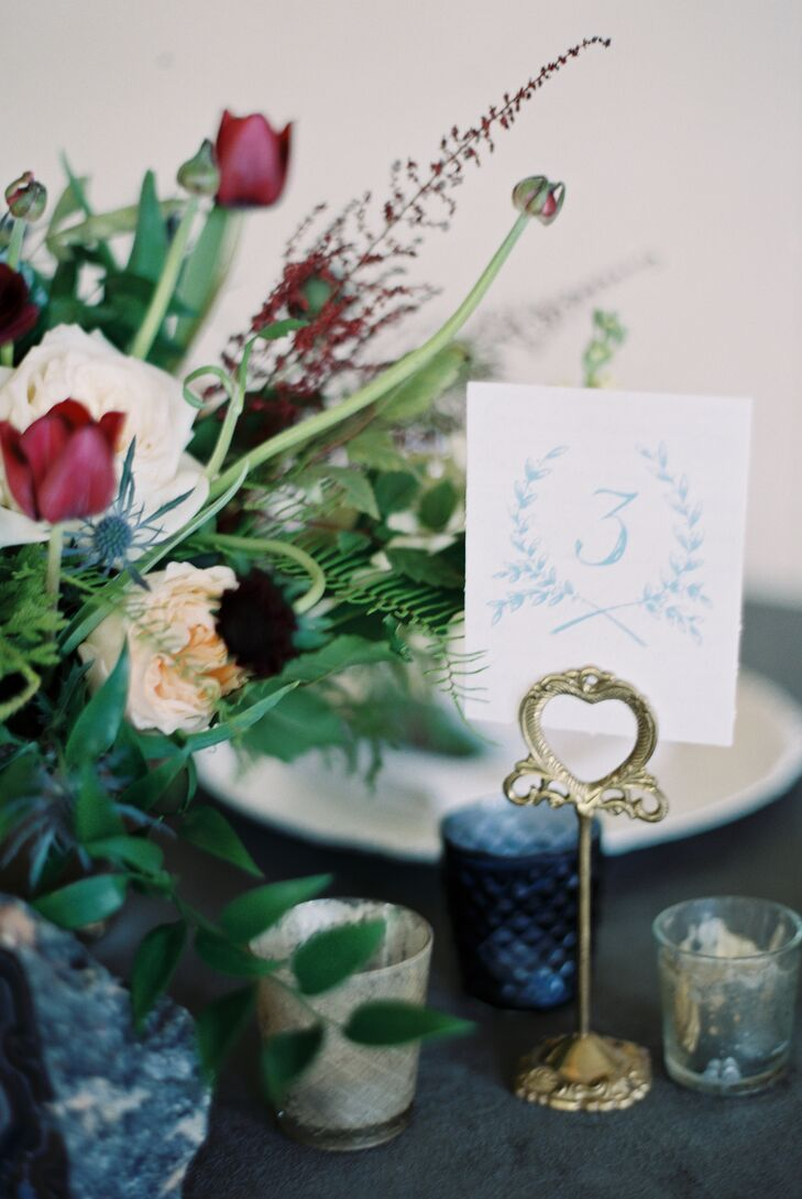 Tammie's calligrapher also created table numbers in indigo blue, which were placed on brass holders. Navy glass votives accented each table's centerpieces.