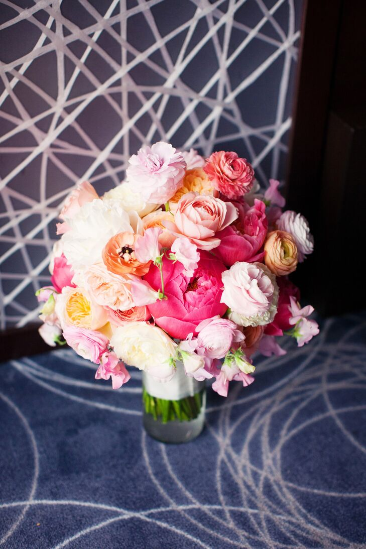 Nicole's bouquet stood out in vibrant shades of pink and peach. The arrangement had peonies, garden roses, ranunculus and many other blooms making up its round shape, arranged by Amy Burke Designs.