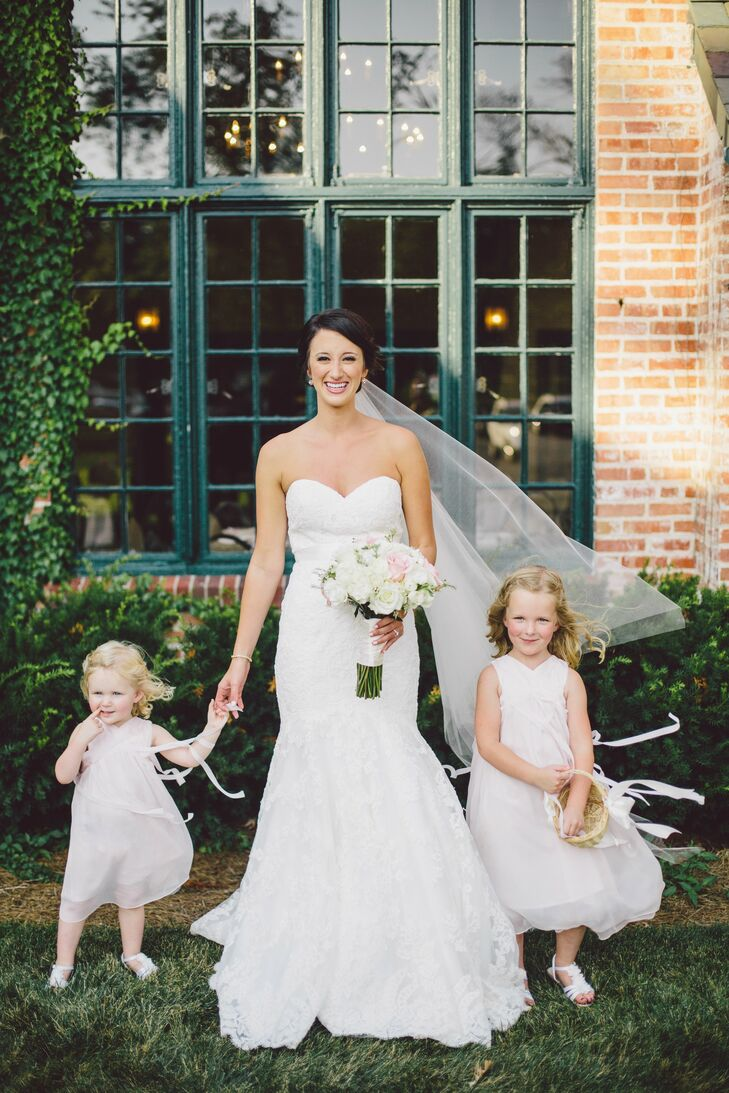 The flower girls wore blush-colored chiffon dresses with high v-shaped necklines and flowing ribbon.