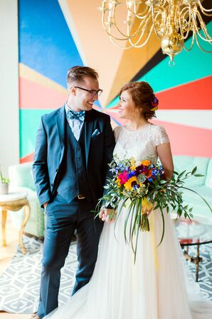Groom in Blue Suit and Bride with Bright Bouquet