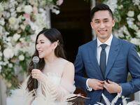 Bride giving speech during wedding reception.