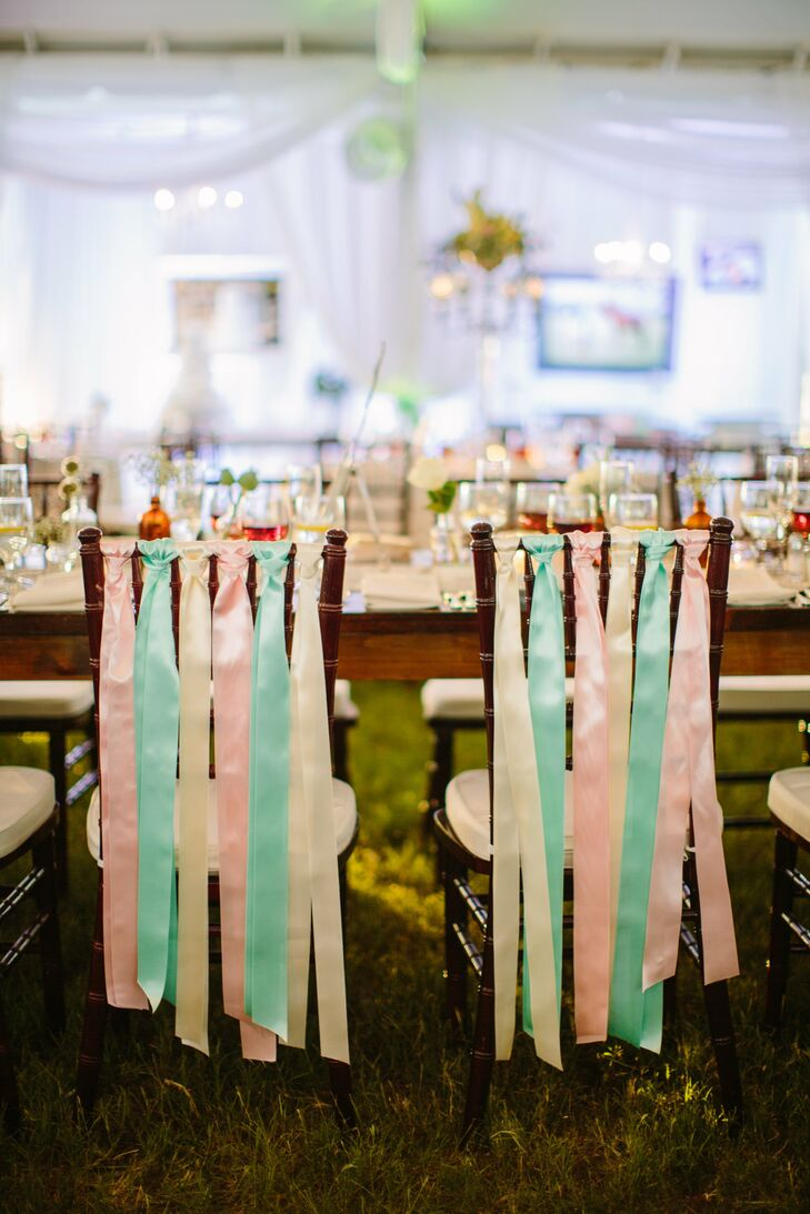 The bride and groom's chairs were designated by the pastel ribbons that hung along the top rungs.