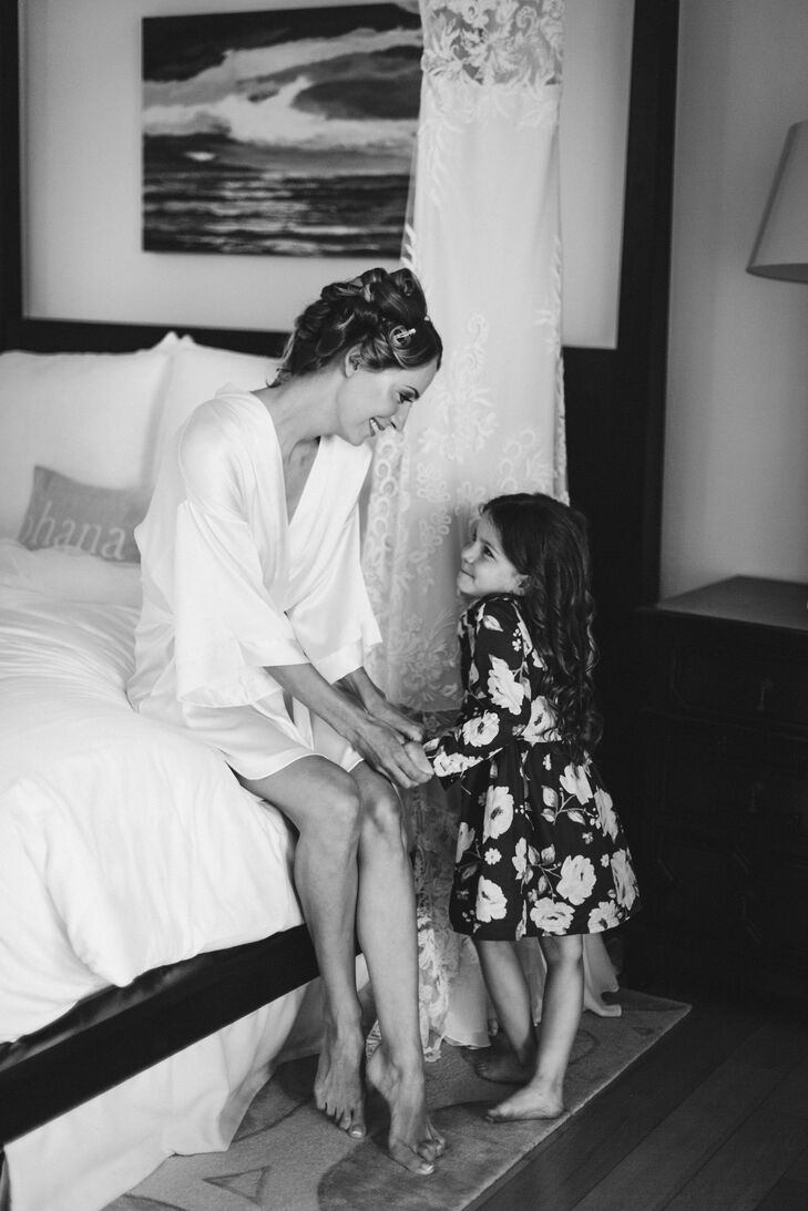 Evgeniya sat with a young guest as she prepped for the ocean view ceremony at Maui's Montage Kapalua Bay Hotel.