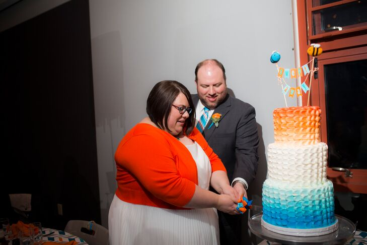 "The vanilla bean cake with buttercream frosting was drag-dot textured buttercream with ombre spray from blue to orange. Suzette and Brad's cake topper was crocheted bees in orange and turquoise, with a ""Swept Away"" banner between the bees. ""I love the way it turned out,"" Suzette says."