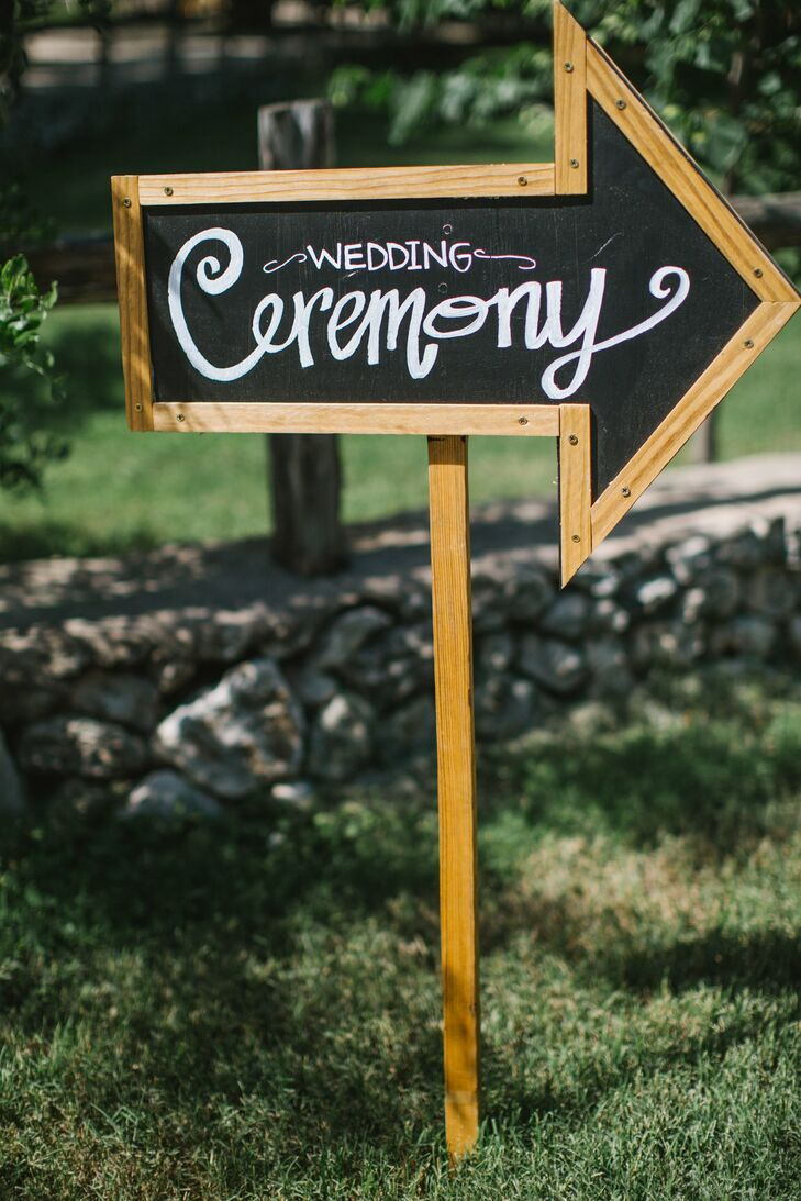 Arrows, painted with chalkboard paint, directed guests to the ceremony.