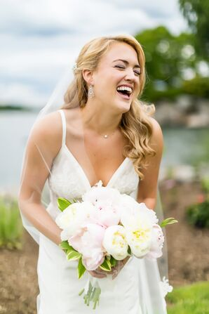 Classic Bride in V-Neck Dress holding Peonies