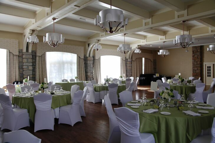 """""""The hotel had a historic feel with modern updates,"""" Whitney says. """"It had the perfect room for our dinner and reception."""" The couple decorated the room with green and white linens."""